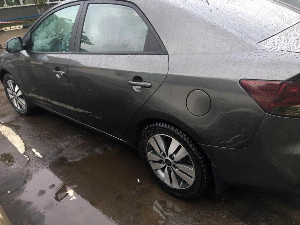 Левая сторона кузова Kia Cerato после восстановления и окраса